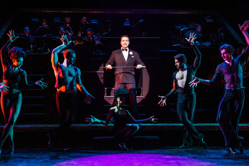 "scene from CHICAGO Billy Flynn and Company performing ""Razzle Dazzle"""